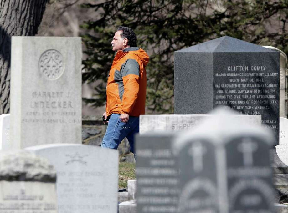 Steve Denardis of the Army Corps. of Engineers walks in the West Point Cemetery on his lunch break on Friday, March 22, 2013, in West Point, N.Y. Graves of soldiers from every U.S. war make this small plot of the land the most hallowed ground on the nation's the most venerable military academy. And after 196 years and more than 8,000 souls, it's close to full. Photo: Mike Groll, AP / AP