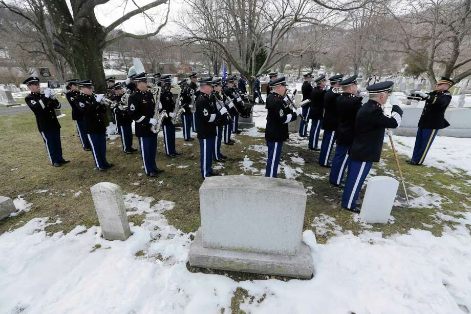 The U.S. Military Academy Band performs during a burial service at the West Point Cemetery on Friday, March 22, 2013, in West Point, N.Y. The service was for Maj. Gen. Robert Strong and wife Virginia Strong. Graves of soldiers from every U.S. war make this small plot of the land the most hallowed ground on the nation's the most venerable military academy. And after 196 years and more than 8,000 souls, it's close to full. Photo: Mike Groll, AP / AP