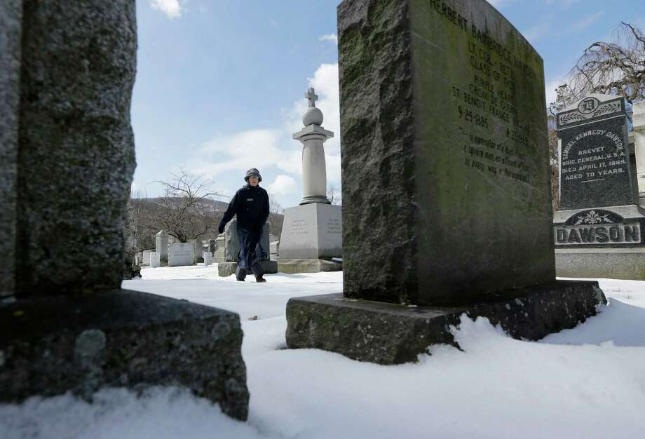 Kathleen Silvia, director of the West Point Cemetery, walks in the cemetery on Friday, March 22, 2013, in West Point, N.Y. Graves of soldiers from every U.S. war make this small plot of the land the most hallowed ground on the nation's the most venerable military academy. And after 196 years and more than 8,000 souls, it's close to full. Photo: Mike Groll, AP / AP