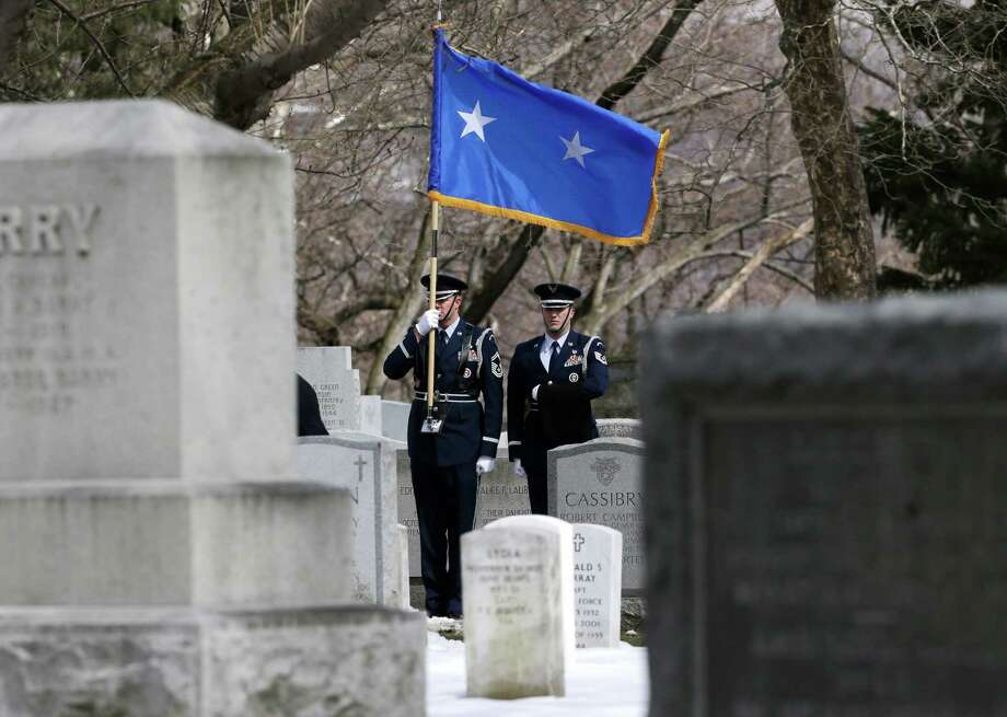 Joint Base McGuire-Dix-Lakehurst Honor Guard members Len Werner, left, and Jared Lacovara stand during a burial service at the West Point Cemetery on Friday, March 22, 2013, in West Point, N.Y. The service was for Maj. Gen. Robert Strong and wife Virginia Strong. Graves of soldiers from every U.S. war make this small plot of the land the most hallowed ground on the nation's the most venerable military academy. And after 196 years and more than 8,000 souls, it's close to full. Photo: Mike Groll, AP / AP