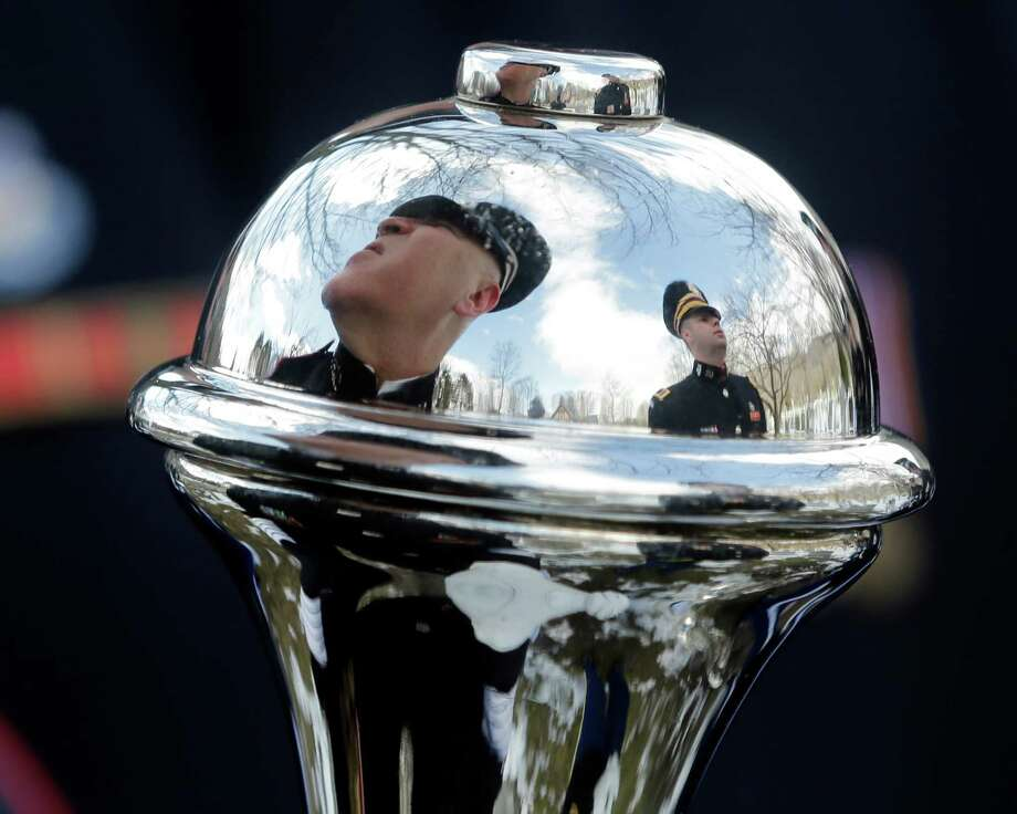 U.S. Military Academy Band members are reflected in a mace during a burial ceremony at West Point Cemetery on Friday, March 22, 2013, in West Point, N.Y. The service was for Maj. Gen. Robert Strong and wife Virginia Strong.Graves of soldiers from every U.S. war make this small plot of the land the most hallowed ground on the nation's the most venerable military academy. And after 196 years and more than 8,000 souls, it's close to full. Photo: Mike Groll, AP / AP