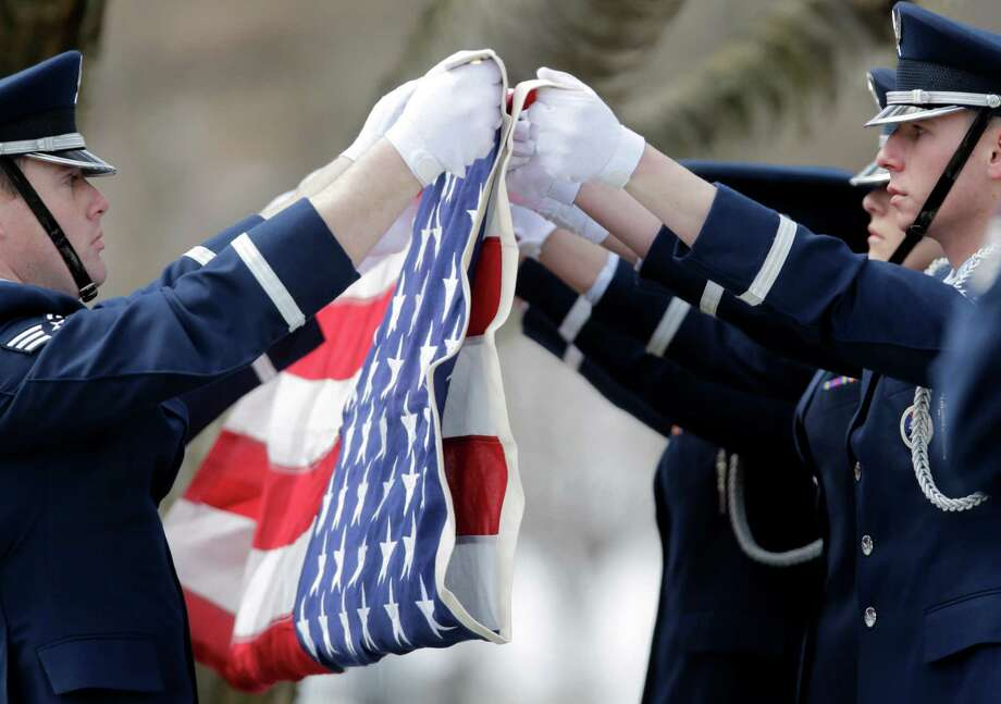 Joint Base McGuire-Dix-Lakehurst Base Honor Guard members fold a flag during a burial service at the West Point Cemetery on Friday, March 22, 2013, in West Point, N.Y. The service was for Maj. Gen. Robert Strong and wife Virginia Strong. Graves of soldiers from every U.S. war make this small plot of the land the most hallowed ground on the nation's the most venerable military academy. And after 196 years and more than 8,000 souls, it's close to full. Photo: Mike Groll, AP / AP