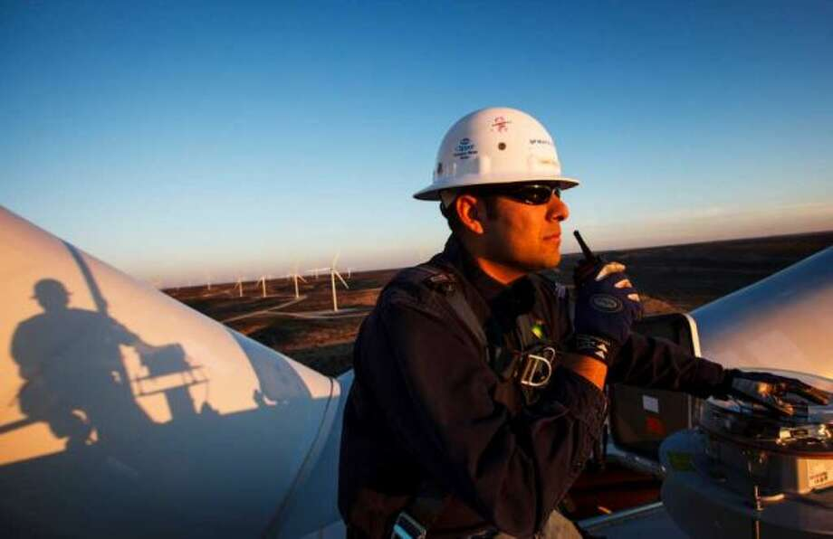 Manny Dominguez of BP's Sherbino 2 wind farm radios the office while working 285 feet in the air atop turbine 53 east of Fort Stockton. BP is beefing up its investments in wind energy and recently launched the wind farm near Fort Stockton, its fourth in Texas. Photo: Michael Paulsen / © 2012 Houston Chronicle