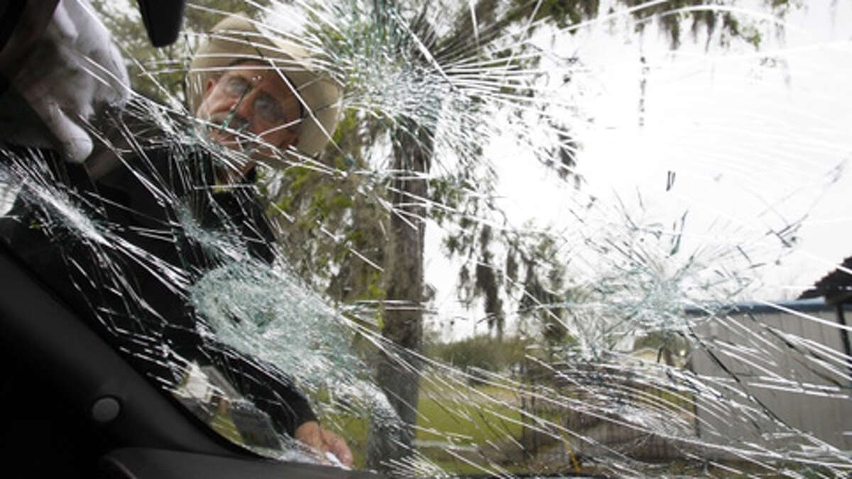 Bob Paulson, of Hondo, Texas, checks on hail damage on a truck while it was parked at the Bostonian Inn & Suites on Wednesday, March, 3, 2013, in Hitchcock, Texas. (Nick de la Torre / Houston Chronicle)