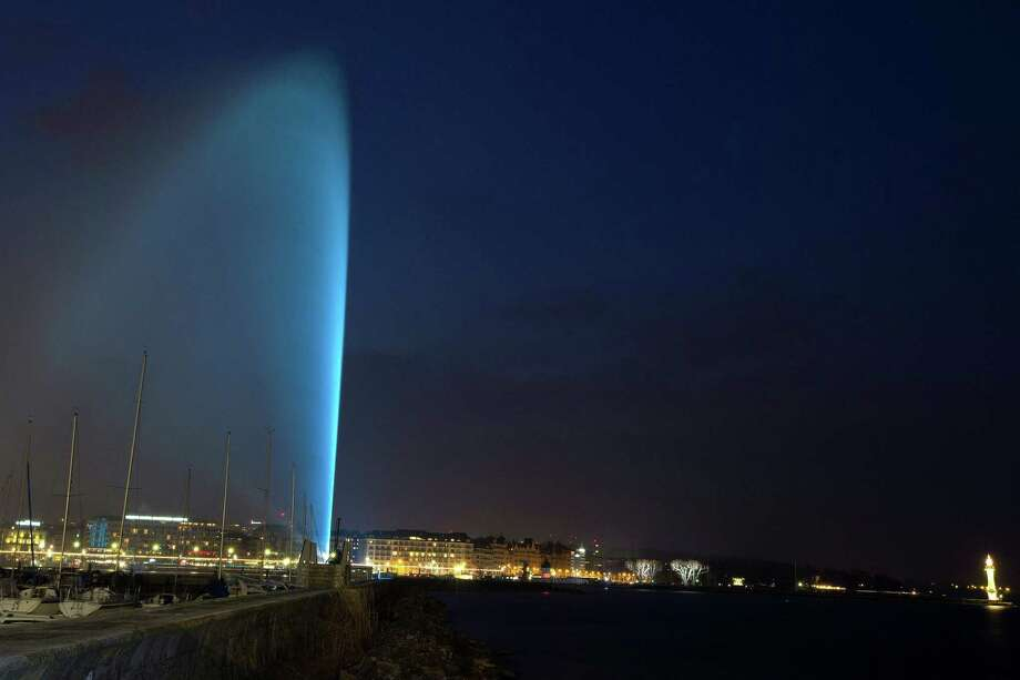 In this picture made available Wednesday April 3, 2013, the  famous water fountain (Jet d'eau) is illuminated by blue lights to mark the Light It Up blue for World Autism Awareness Day, in Geneva, Switzerland, Tuesday, April 2, 2013. Photo: Salvatore Di Nolfi, Associated Press / KEYSTONE