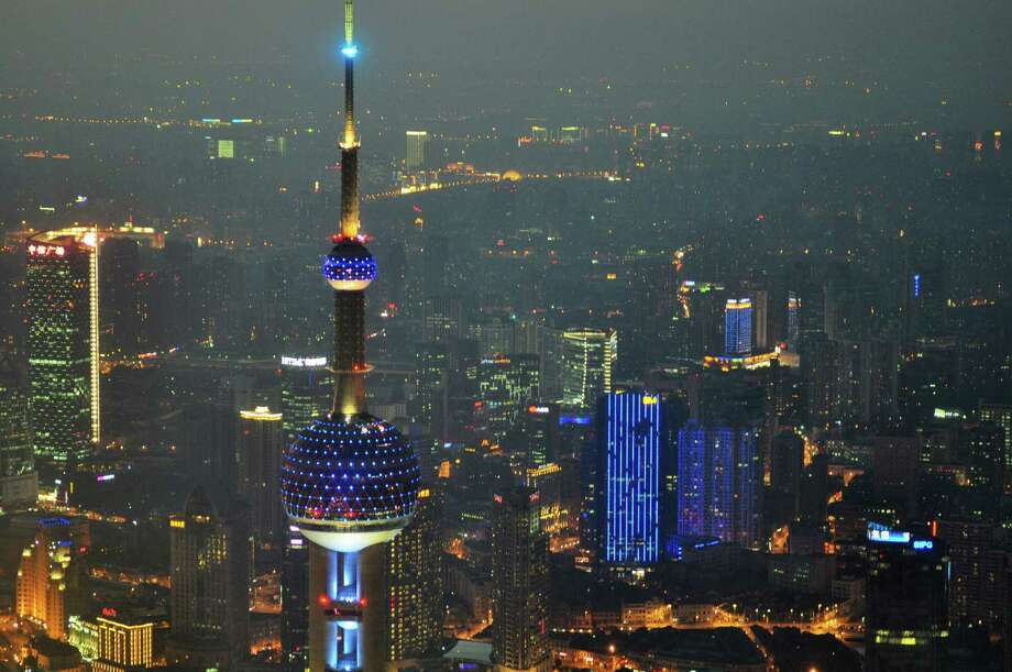 SHANGHAI, CHINA - APRIL 02:  (CHINA OUT) The Oriental Pearl TV Tower is illuminated in blue on World Autism Awareness Day on April 2, 2013 in Shanghai, China. World Autism Awareness Day falls on April 2 every year. Photo: ChinaFotoPress, Getty Images / 2013 Getty Images