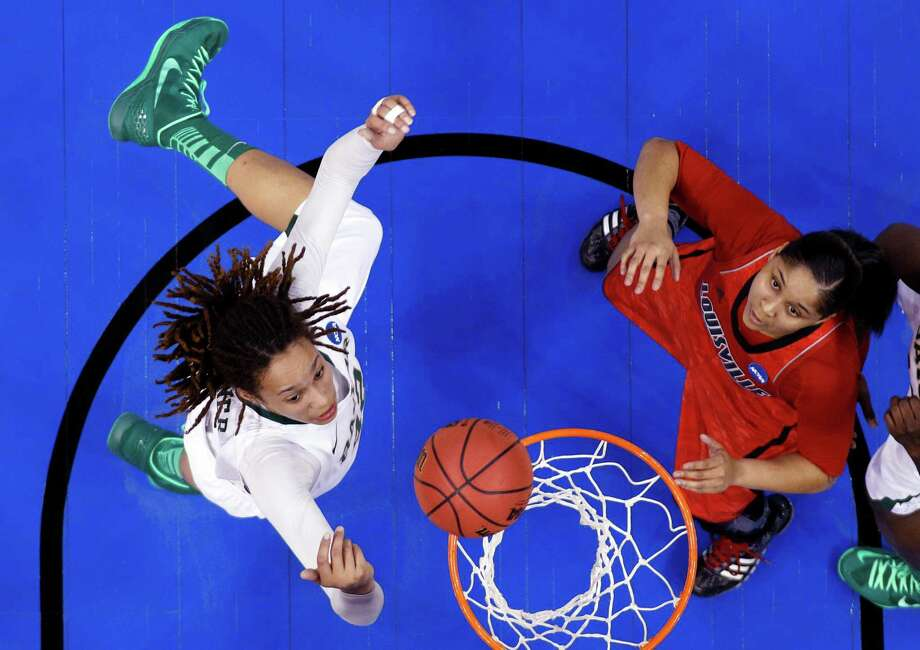 Baylor's Brittney Griner (42) and Louisville forward Monique Reid (33) reach for a rebound in the first half of a regional semifinal in the women's NCAA college basketball tournament in Oklahoma City, Sunday, March 31, 2013. Louisville won 82-81. (AP Photo/Sue Ogrocki) Photo: Sue Ogrocki, STF / AP