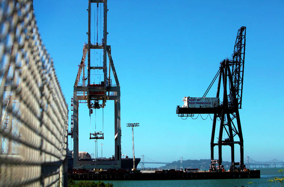 A pair of ospreys built their nest at the top of the crane, right, at the end of Pier 80, shown in San Francisco, Calif., Tuesday, July 3, 2012. Photo: Sarah Rice, Special To The Chronicle / ONLINE_YES