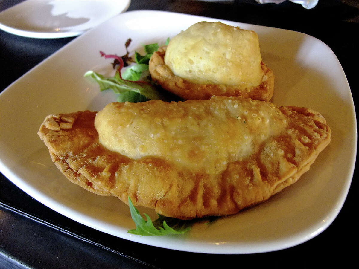 One of the many empanada combinations Tango & Malbec features creamed corn and onion with white cheese.
