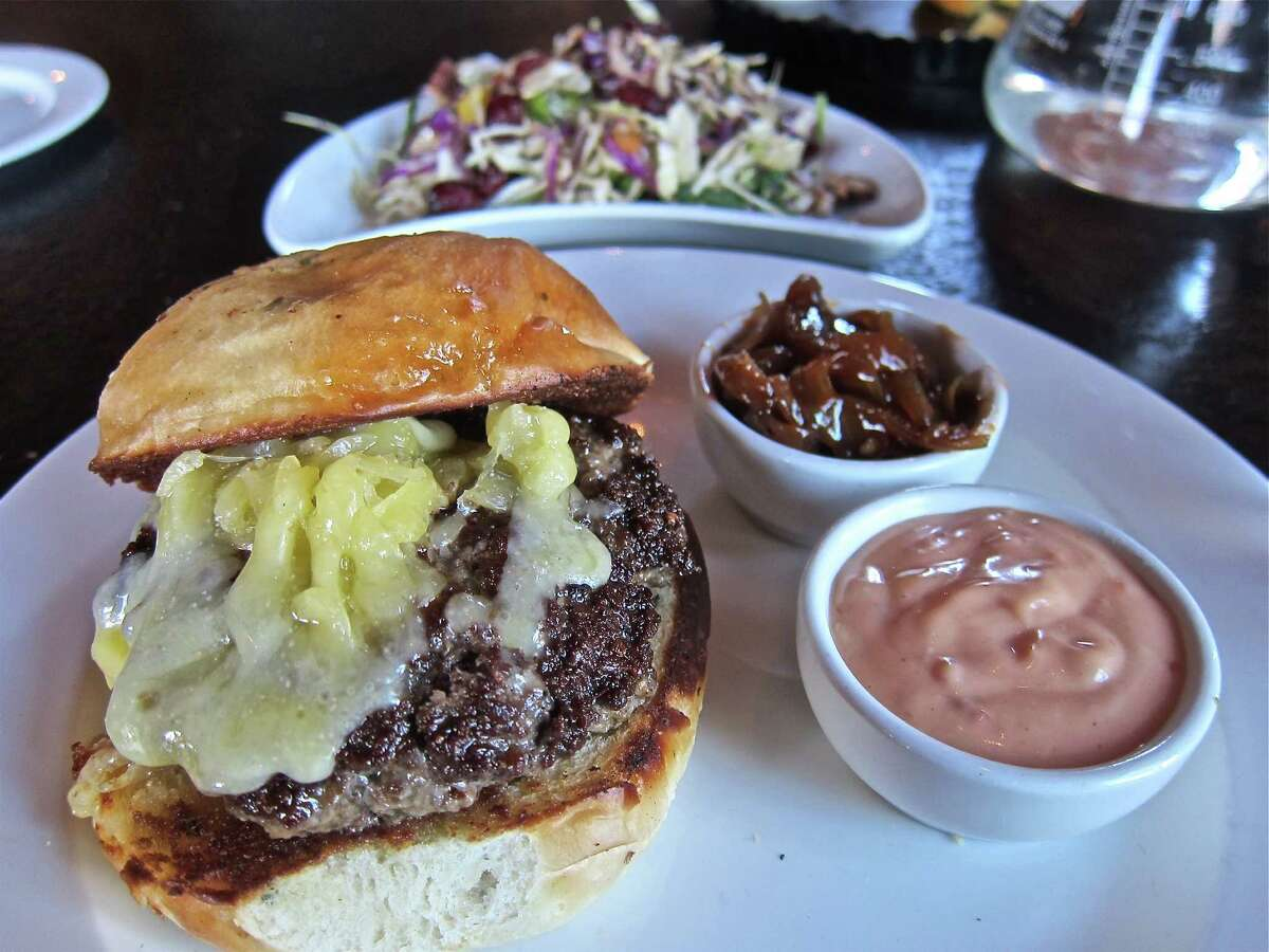 The Built Burger at Sparrow features Longhorn beef topped with cheddar and comes with hot dog onions and Sparrow special sauce.