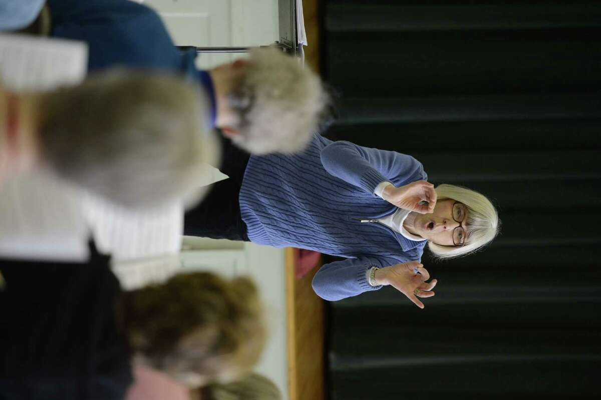 Choir Director Julie Panke leads the voices of the Thursday Musical Club at the First Reformed Church of Schenectady during rehearsal for their 100th anniversary March 20, 2013, in Schenectady, N.Y. (Skip Dickstein/Times Union)