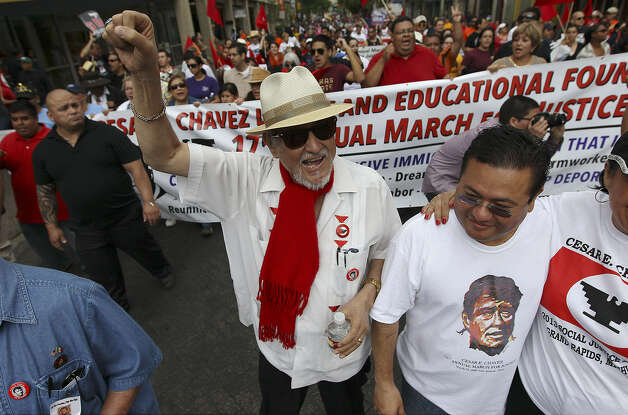 """Jaime Martinez (center) founder of the César E. Chávez Legacy and Educational Foundation leads the 17th annual César E. Chávez March for Justice on March 30. Martinez, who has cancer, says, """"The march will continue long after we're gone."""" Photo: Kin Man Hui / Express-News"""