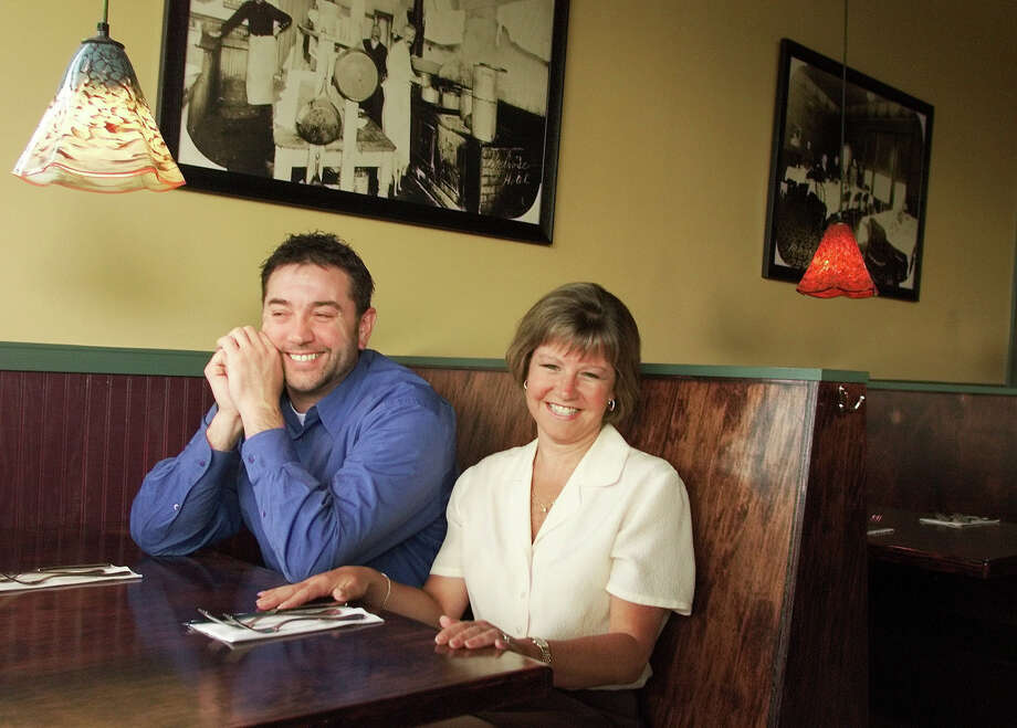 Melrose Grill is a neighborhood steakhouse in Renton. Here, owners Armondo Pavone and Kimberly Searine are shown there in 2002. Photo: MERYL SCHENKER, SEATTLE POST-INTELLIGENCER