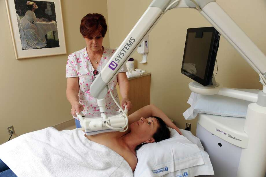 Marta Bright undergoes an Automated Breast Ultrasound Device (ABUS) study given by Audrey Pitcher to supplement her screening mammogram at El Camino Hospital on March 29, 2013. This study can be used as an adjunct study in women with dense breasts. Photo: Susana Bates, Special To The Chronicle / ONLINE_YES
