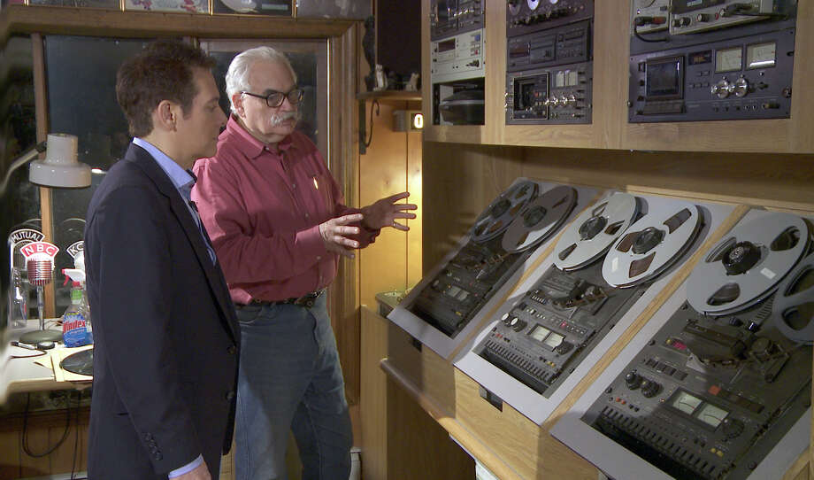 "Radio historian David Goldin shows Michael Feinstein how he preserves his collection of more than 27,000 radio programs, in his home in Sandy Hook, Conn. Goldin and his archive are featured in the third episode of the PBS series âÄúMichael FeinsteinâÄôs American Songbook,âÄù in a program focusing on the impact of radio, titled ""On the Air."" Photo: Contributed Photo"