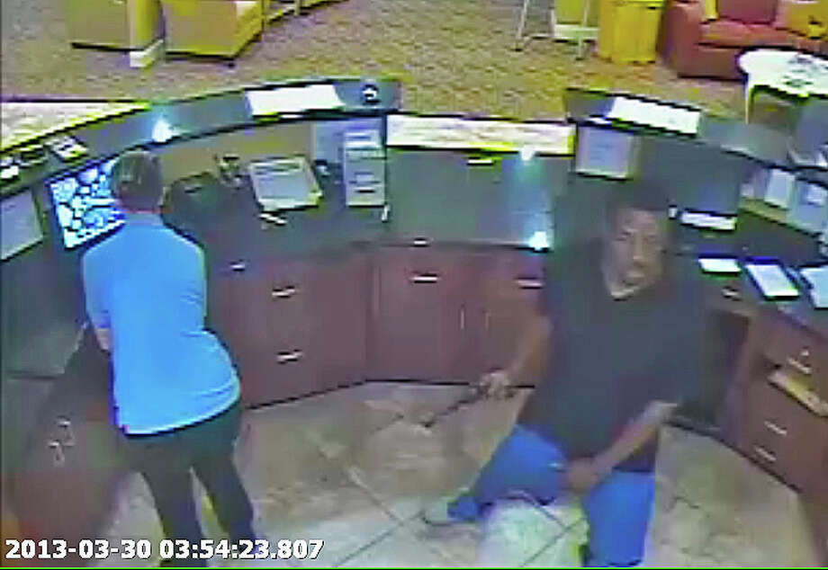This unidentified man robbed the Comfort Suites in Pearland on March 30. He was carrying what police called a large black revolver with wood grips. Photo: Pearland Police Department