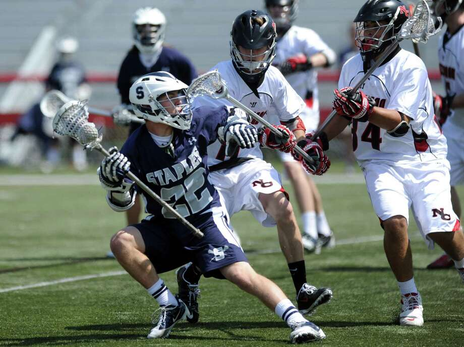Staples' Joey Zelkowitz controls the ball during Saturday's lacrosse game at New Canaan High School on April 21, 2012. Photo: Lindsay Niegelberg / Stamford Advocate