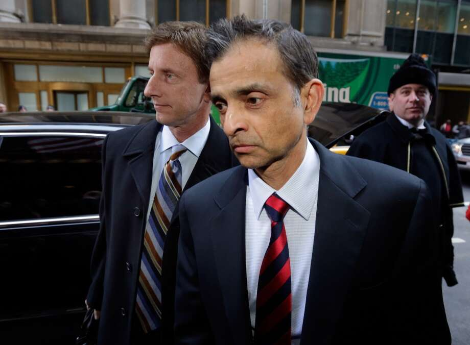 Mark Mastrov, left, and Vivek Ranadive, two of the three men who are key to Sacramento's effort to keep the Sacramento Kings, arrive for an NBA owners meeting regarding the the possible relocation of the Kings to Seattle, in New York, Wednesday, April 3, 2013. Hedge fund manager Chris Hansen and Microsoft Chief Executive Steve Ballmer have agreed to buy a majority stake in the Kings from the Maloof family for $341 million, but the deal needs league approval.