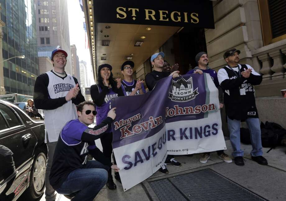 Sacramento Kings supporters gather outside the hotel where NBA owners are meetings regarding the possible relocation of the Sacramento Kings  team to Seattle, in New York,  Wednesday, April 3, 2013. Hedge fund manager Chris Hansen and Microsoft Chief Executive Steve Ballmer have agreed to buy a majority stake in the Kings from the Maloof family for $341 million, but the deal needs league approval.