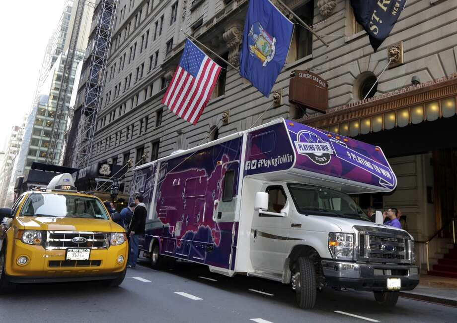 The ''Playing to Win'' tour  RV is parked outside the hotel where NBA owners are meeting regarding the possible relocation of the Sacramento Kings team to Seattle, in New York, Wednesday, April 3, 2013. Hedge fund manager Chris Hansen and Microsoft Chief Executive Steve Ballmer have agreed to buy a majority stake in the Kings from the Maloof family for $341 million, but the deal needs league approval.