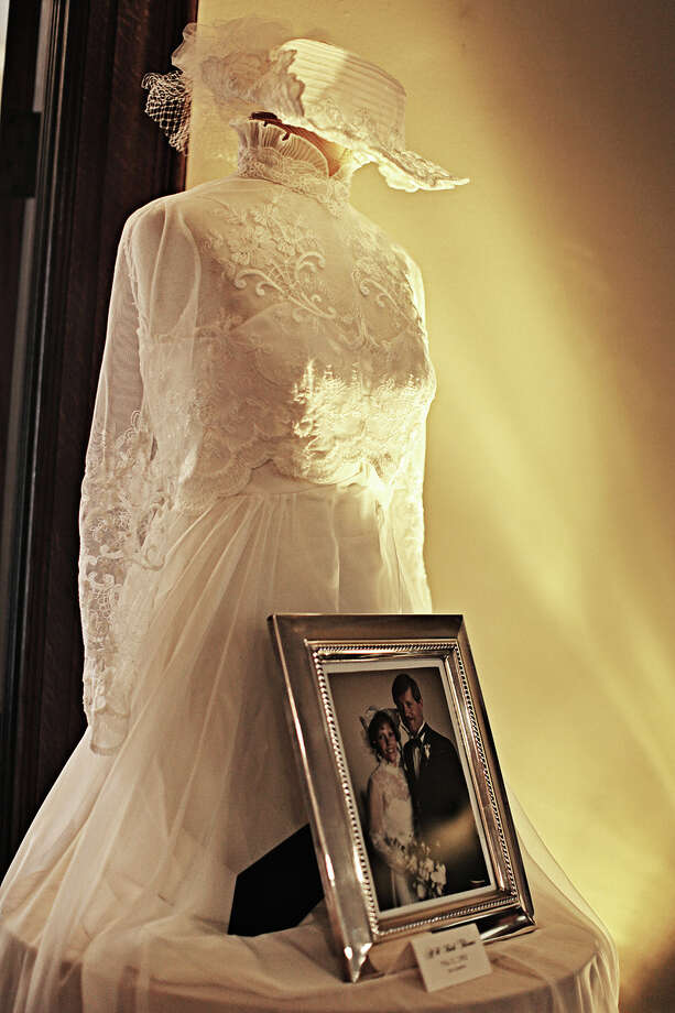 This undated photo provided by Moxie Photography shows a display of vintage wedding dresses belonging to members of the family, that one couple displayed at their wedding reception. Personalizing the décor is a popular trend in wedding receptions, and there are many creative, inexpensive ideas to be found on the Internet's bridal sites and pin boards. Photo: Moxie Photography, Diana Vermeulen