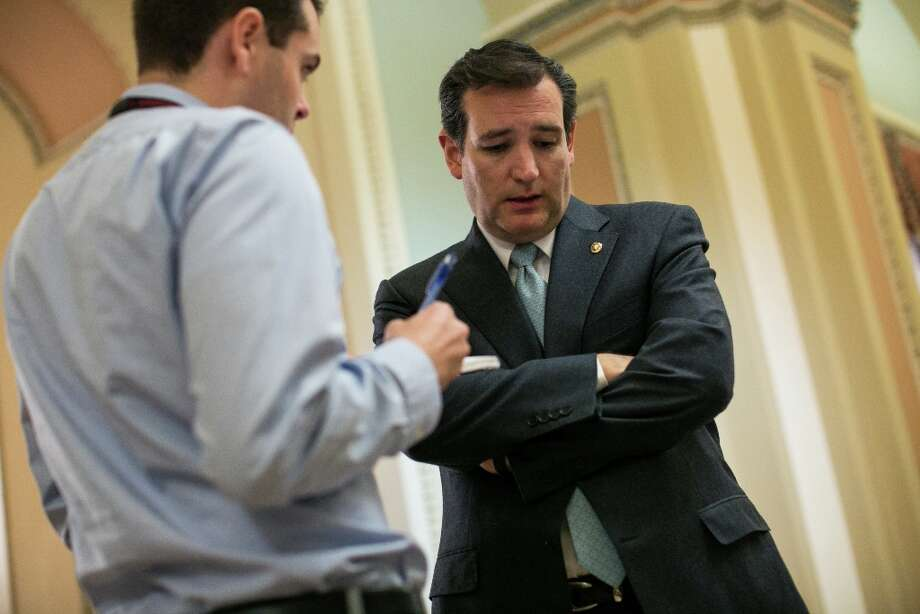 WASHINGTON, DC - MARCH 22:  U.S. Sen. Ted Cruz (R-TX) talks with a reporter outside the Senate chamber on Capitol Hill March 22, 2013 in Washington, DC. The Senate voted on amendments to the budget resolution on Friday afternoon and into the evening. Photo: Drew Angerer, Getty Images / 2013 Getty Images