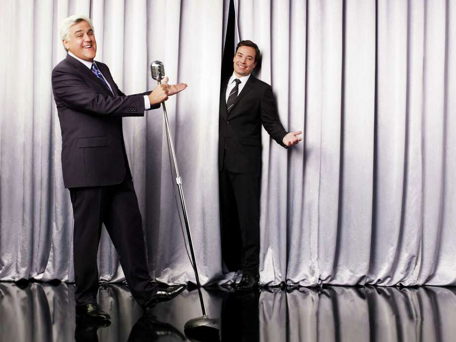 "This undated promotional image released by NBC shows Jay Leno, host of ""The Tonight Show with Jay Leno,"" left, and Jimmy Fallon, host of ""Late Night with Jimmy Fallon,"" in Los Angeles. NBC on Wednesday, April 3, 2013 announced its long-rumored switch in late night, replacing incumbent Jay Leno at ""The Tonight Show"" with Jimmy Fallon and moving the iconic franchise back to New York. Leno will wrap up what will be 22 years of headlining the iconic late-night show in Spring 2014.  ""Saturday Night Live"" producer Lorne Michaels will take over as producer of the new ""Tonight Show."" (AP Photo/NBC, Andrew Eccles) Photo: Andrew Eccles"