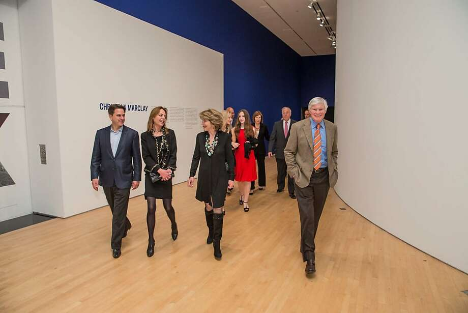 """Guests chat during SFMOMA's presentation of artist Christian Marclay's """"The Clock"""" on April 2, 2013. Photo: Drew Altizer Photography"""