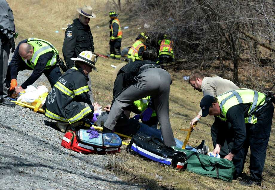Two people were transported to a hospital from the scene of a rollover in the southbound lane of Interstate 87 south of exit 8 April 3, 2013 in Crescent, N.Y.    (Skip Dickstein/Times Union) Photo: SKIP DICKSTEIN