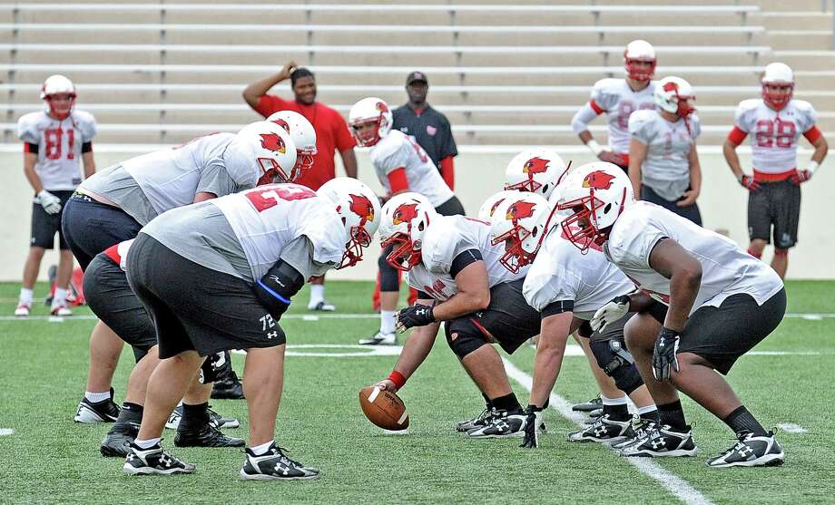 The Lamar University lineman work on drills in football practice on Tuesday, April 2, 2013. Photo taken: Randy Edwards/The Enterprise Photo: Randy Edwards