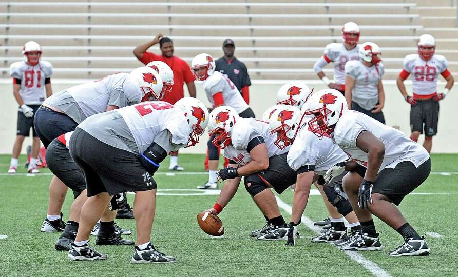 The Lamar University lineman work on drills in football practice on Tuesday, April 2, 2013. Photo ta