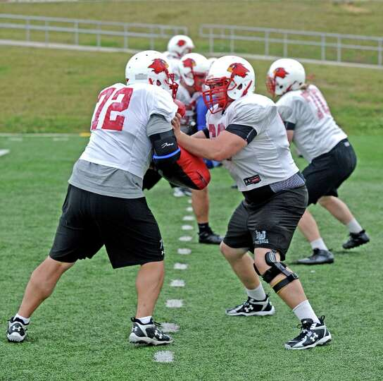 The Lamar University offensive lineman work on drills in football practice on Tuesday, April 2, 2013