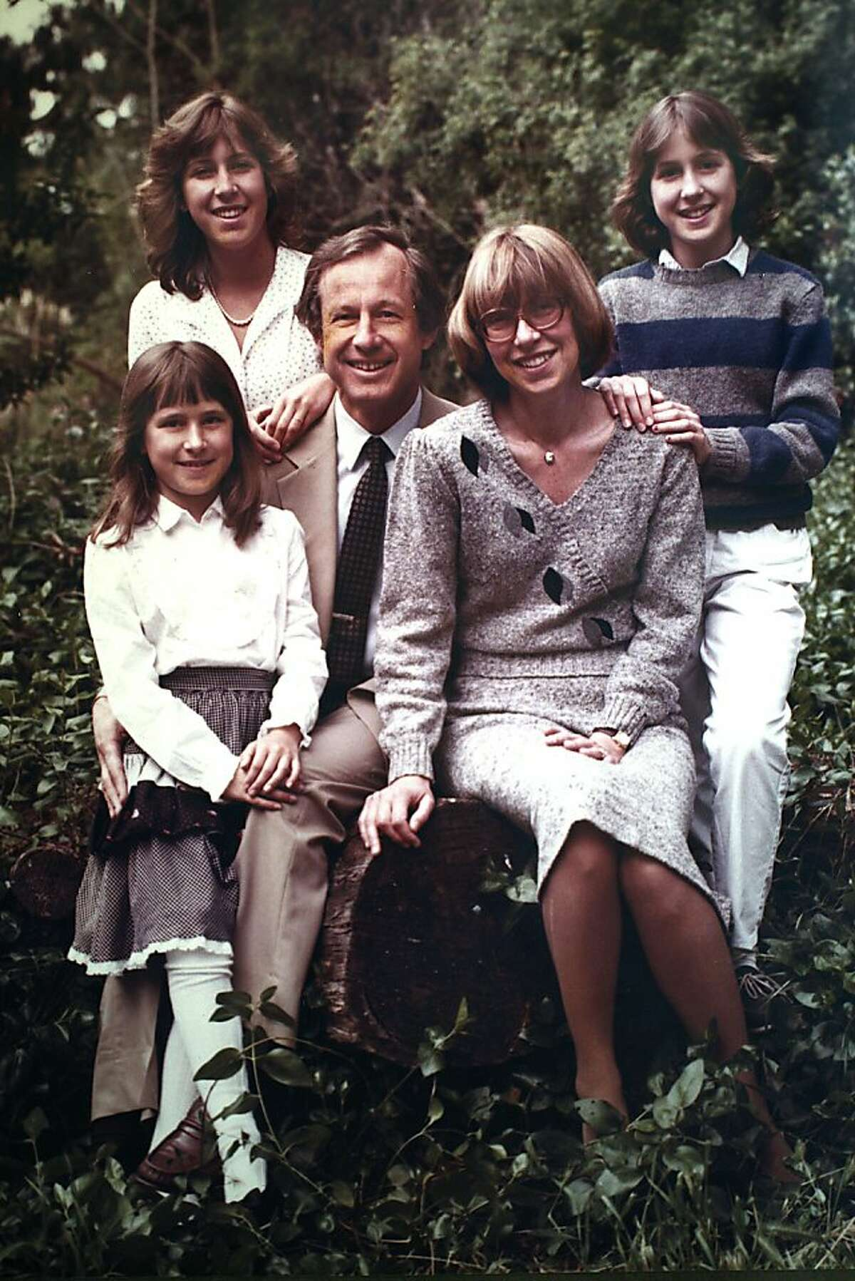 Clockwise from front--Anne Wojcicki (left front), Susan Wojcicki (left back), Stanley Wojcicki (middle), Esther Wojcicki (middle), and Janet Wojcicki (back right) in a portrait taken on the Stanford campus in Palo Alto, California, around 1982.