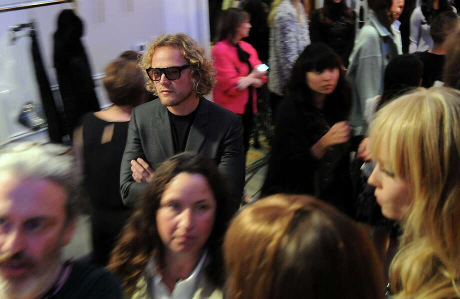 Pucci designer Peter Dundas looks over the models backstage at the annual Houston Chronicle's Best Dressed Luncheon at the Westin Galleria Hotel Tuesday April 3, 2013.(Dave Rossman photo) Photo: Dave Rossman, For The Houston Chronicle / © 2013 Dave Rossman