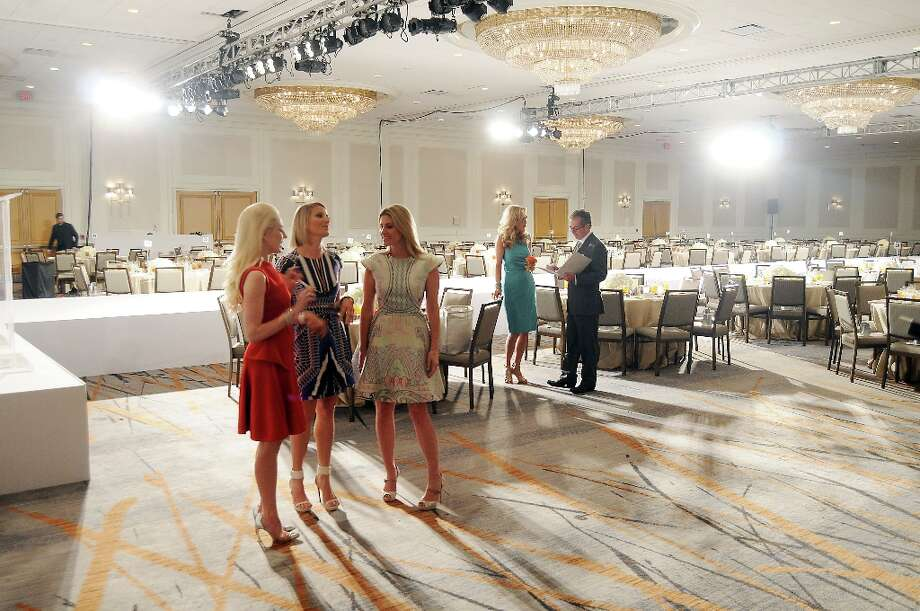 Honorees Isabel David, Stephanie Cockrell and Greggory Burk chat before the annual Houston Chronicle's Best Dressed Luncheon at the Westin Galleria Hotel Tuesday April 3, 2013.(Dave Rossman photo) Photo: Dave Rossman, For The Houston Chronicle / © 2013 Dave Rossman