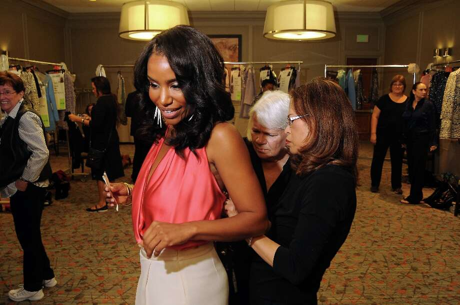 Honoree Tiffany Avery Smith gets an adjustment backstage at the annual Houston Chronicle's Best Dressed Luncheon at the Westin Galleria Hotel Tuesday April 3, 2013.(Dave Rossman photo) Photo: Dave Rossman, For The Houston Chronicle / © 2013 Dave Rossman