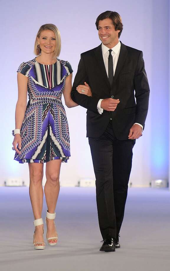 Honoree Stephanie Cockrell is escorted down the runway at the annual Houston Chronicle's Best Dressed Luncheon at the Westin Galleria Hotel Tuesday April 3, 2013.(Dave Rossman photo) Photo: Dave Rossman, For The Houston Chronicle / © 2013 Dave Rossman