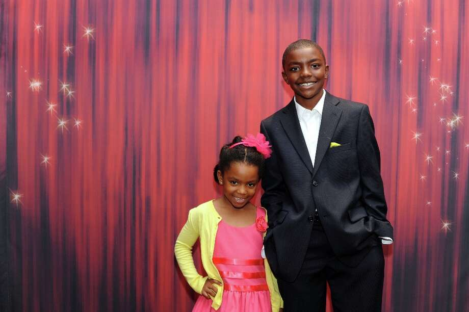 Avery and Robert Smith (left to right) pose at the Houston Chronicle's 31st annual Best Dressed luncheon, at the Westin Galleria Hotel, Houston, Texas on the 3rd April 2013. Photo: Spike Johnson, For The Chronicle / Spike Johnson