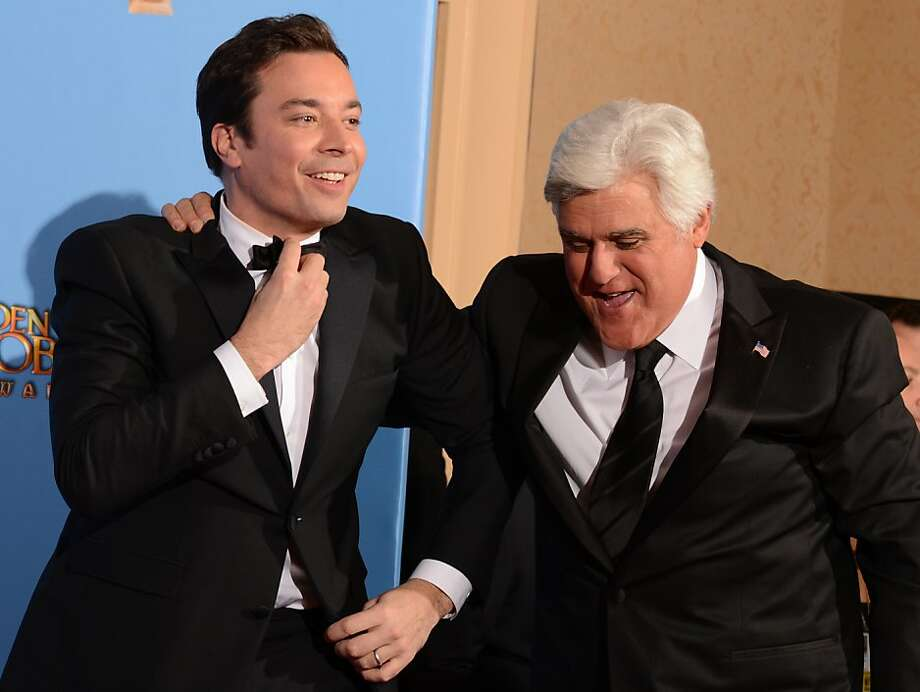 """(FILES)Comedians Jimmy Fallon (L) and """"Tonight Show"""" host Jay Leno pose in the press room at the Golden Globes awards ceremony in Beverly Hills in this January 13, 2013 file photo. Veteran US late-night TV host Jay Leno will bow out after 22 years on the """"Tonight Show"""" next year, making way for the young star Jimmy Fallon, NBC announced April 3, 2013. Confirming weeks of reports, the broadcaster said production of the iconic show will move from Los Angeles to New York, where Fallon's """"Late Night with Jimmy Fallon"""" is already made.   AFP PHOTO/Robyn BECK / FILESROBYN BECK/AFP/Getty Images Photo: Robyn Beck, AFP/Getty Images"""
