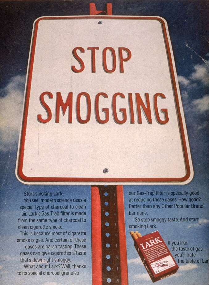 A 1970 print ad for Lark brand cigarettes showing a road sign with the slogan, 'Stop Smogging.' Photo: Blank Archives, Getty Images / 2003 Getty Images