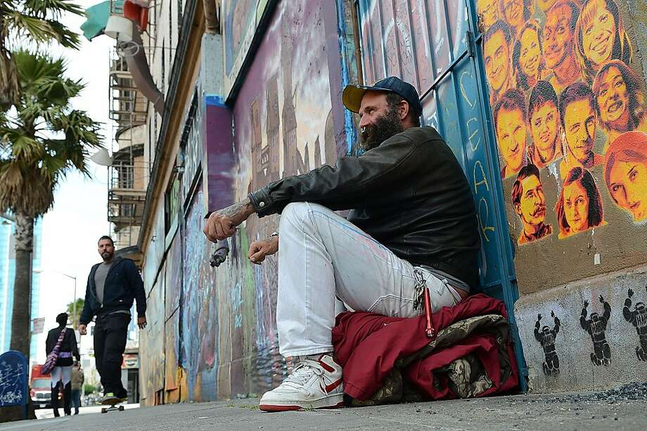 Damian Chapman, a 43-year-old homeless man, sits outside the long-closed Hugo Hotel. Photo: Sean Havey, The Chroncile