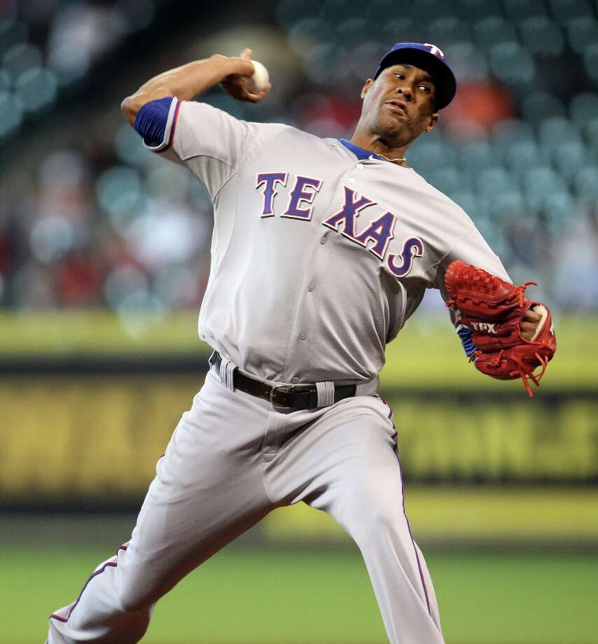 Rangers starting pitcher Alexi Ogando throws during the second inning. Photo: Karen Warren / © 2013 Houston Chronicle