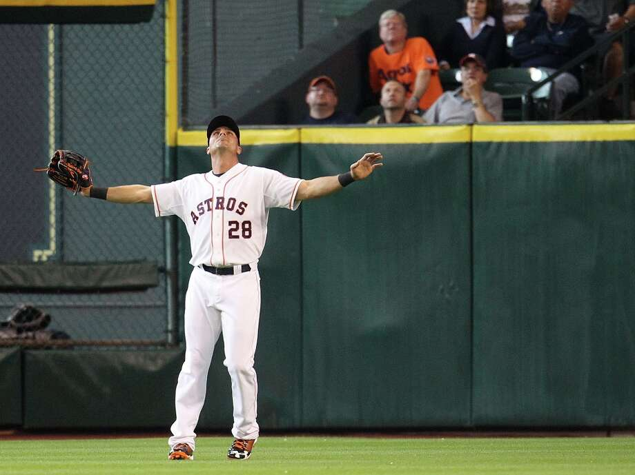 Astros Rick Ankiel prepares to catch a pop fly by Rangers second baseman Ian Kinsler during the second inning. Photo: Karen Warren / © 2013 Houston Chronicle