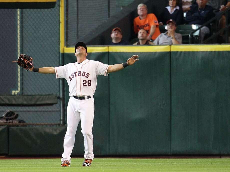 Astros Rick Ankiel prepares to catch a pop fly by Rangers second baseman Ian Kinsler during the second inning. Photo: Karen Warren / © 2013 Houston Chronicle