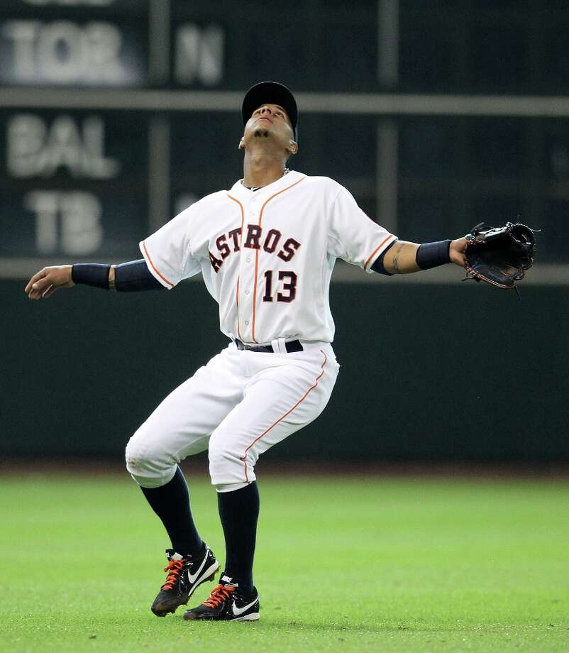 Astros shortstop Ronny Cedeno signals that hes got the pop fly by Rangers shortstop Elvis Andrus during the fifth inning. Photo: Karen Warren / © 2013 Houston Chronicle