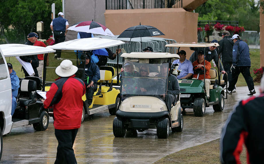 Golfers are forced off the course by severe weather as they play in the pro am tournament at the Valero Texas Open on  April 3, 2013. Photo: TOM REEL