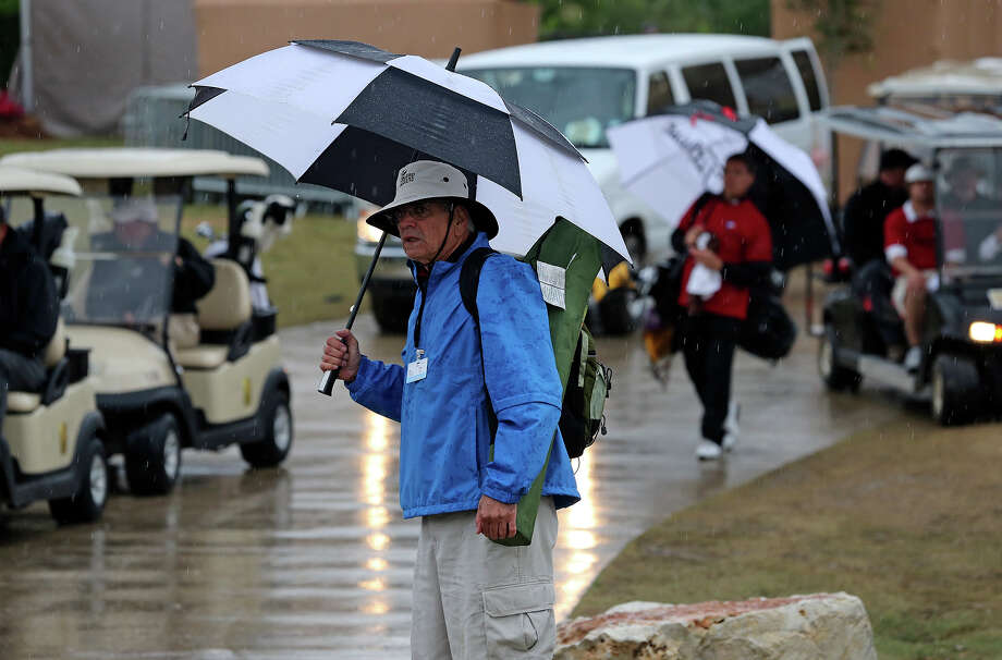 Rains sends golfers and officials packing as play is interupted by severe weather at the pro am tournament at the Valero Texas Open on  April 3, 2013. Photo: TOM REEL