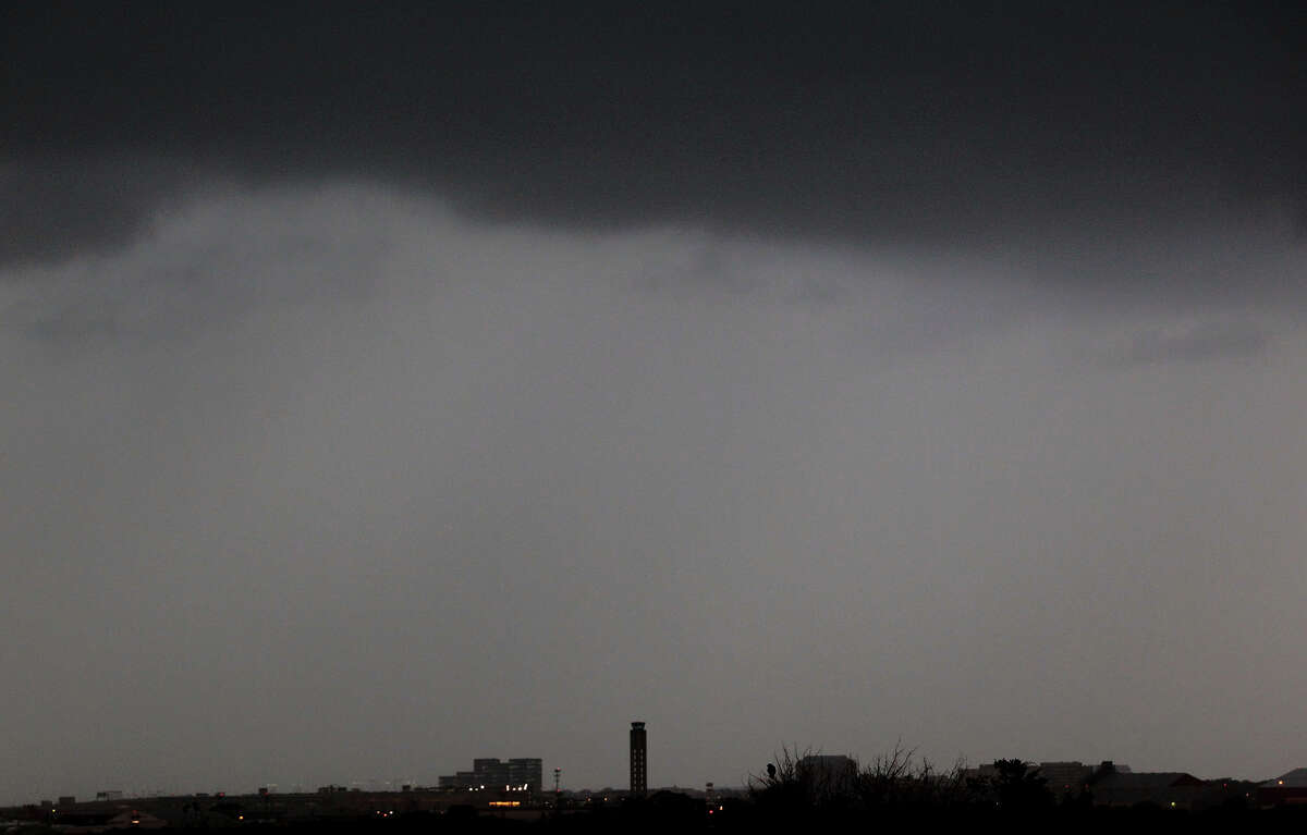 Clouds move in over the control tower (center) at San Antonio International Airport Wednesday April 3, 2012 after storms moved through San Antonio and the Hill Country.