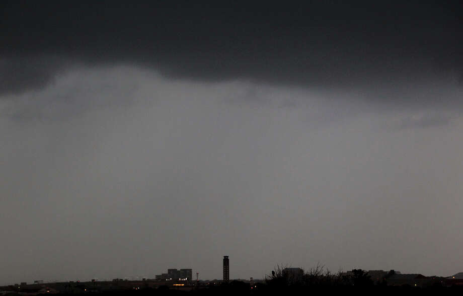 Clouds move in over the control tower (center) at San Antonio International Airport Wednesday April 3, 2012 after storms moved through San Antonio and the Hill Country. Photo: JOHN DAVENPORT, SAN ANTONIO EXPRESS-NEWS / ©San Antonio Express-News/Photo may be sold to the public