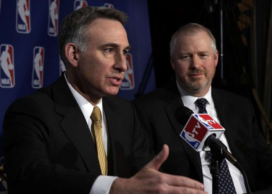 King County Executive Dow Constatine, left, and Seattle Mayor Michael McGinn are interviewed after their meeting with the NBA regarding the possible relocation of the Sacramento Kings basketball team to Seattle, in New York, Wednesday, April 3, 2013. Hedge fund manager Chris Hansen and Microsoft Chief Executive Steve Ballmer have agreed to buy a majority stake in the Kings from the Maloof family for $341 million, but the deal needs league approval.